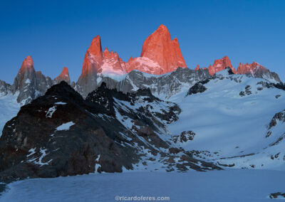 Laguna de los Tres frozen after a strong winter with the sunrise giving the Fitz Roy Massif an orange hue. Photo with 47 cm x 31 cm (18 in x 12 in).